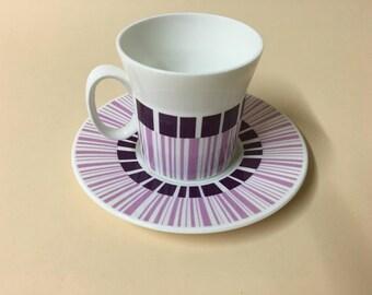 Set of four teacups striking purple design
