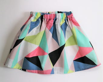 Girls geo print skirt in black, white, pink, green yellow and blue made from 100% cotton, sizes 0-5/6 years