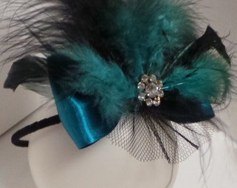 A beautiful black and turquoise/teal fascinator headband