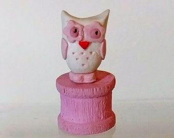 Owl, owl on wooden spool
