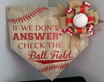 If we don't answer check the ball field Home Plate Door Hanger