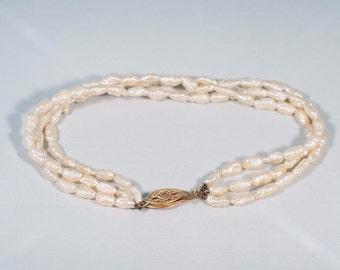 "14K Yellow Gold Triple Strand Freshwater Pearl Bracelet, 6.5"" long"
