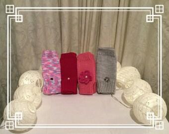 Handmade crochet fingerless gloves in different colours.