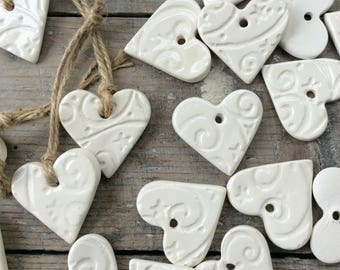 Handmade Ceramic hanging white stars and swirls hearts ornaments.  Christmas gift tags, decorations, Valentine's Day, wedding favours