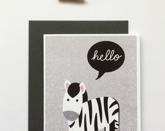 Cute postcard with zebra illustration and the tekst hello, including anthracite envelope.