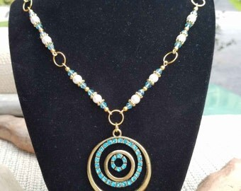 Blue and gold tone with crystal bicones Necklace