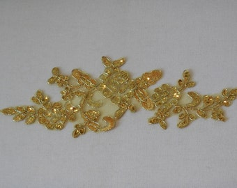 A gold sequined floral lace applique / bridal wedding sequined lace motif is for sale . sold by per piece