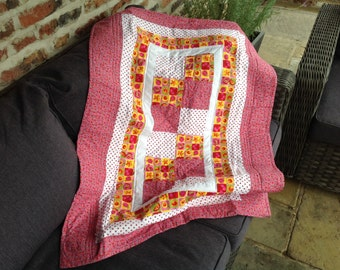Patchwork lap quilt, baby quilt, quilted throw, cot quilt in summer flower and spotted cotton fabrics in red, pink, yellow and white.