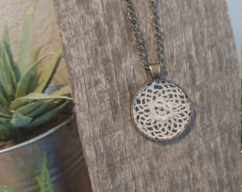Vintage doily pendant with brass chain