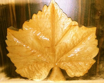 Hand carved grape leaf
