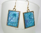 Blue Pebeo Prisme Paint Earrings in a goldtone frame