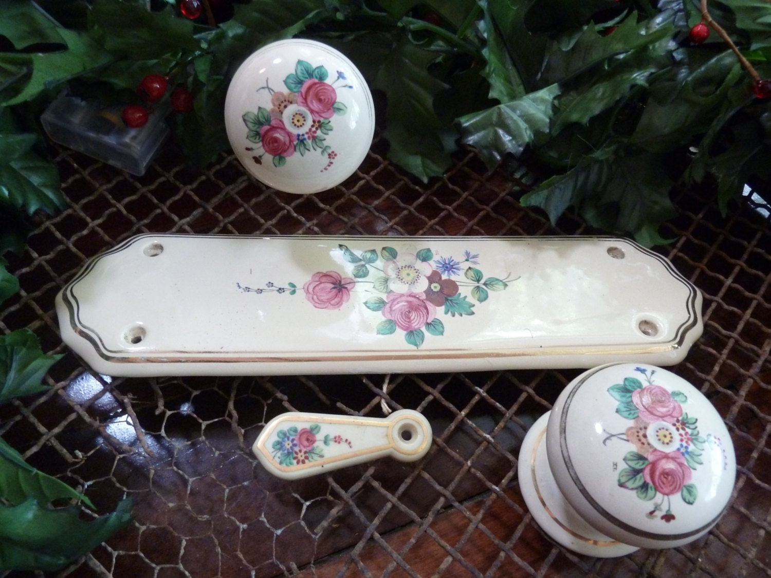 two porcelain door knobs and one door plate and escutchion