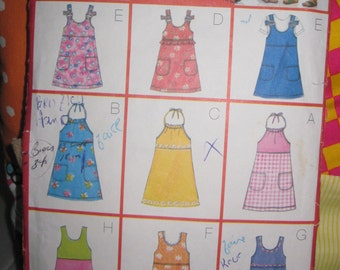 Pattern Butterick 6102 Easy 9 models of dress for girls size: 2-4 years