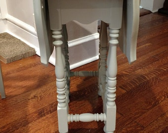small shabby chic gate leg table in a modern gray green color