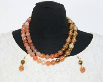 Two strands of carmelian gemstones beads and pyrite stones adorned with handmade gold plated wired beads.