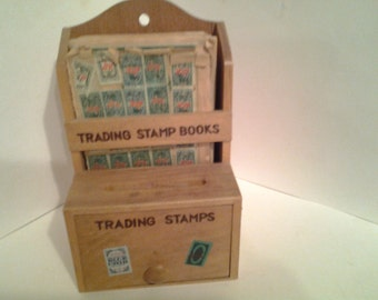1957 S and H green stamp holder, stamps and books
