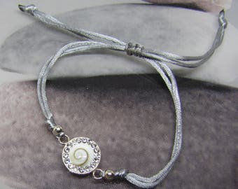 Bracelet silver gray cord and St. Lucia round eye