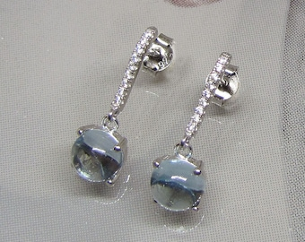 Translucent Blue Topaz stones mounted on Sterling Silver earrings