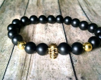 Black and gold skull bracelet