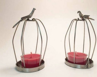 Bird cage candle holders.