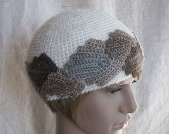 White crochet winter hat, beige-brown-grey color leaves all around the hat, winter hat for woman.