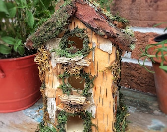 Fairy house birdhouse with bark, lichen and moss
