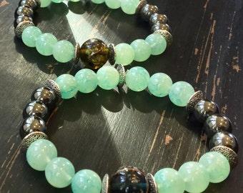 Pale green and metal lampwork beaded bracelet set
