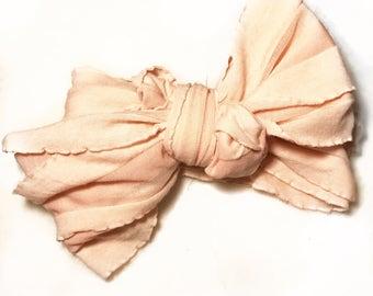 Blush pink ruffle wrap