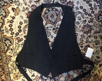 A 1930s backless and adjustable formal vest, perfect in its backlessness and adjustableness