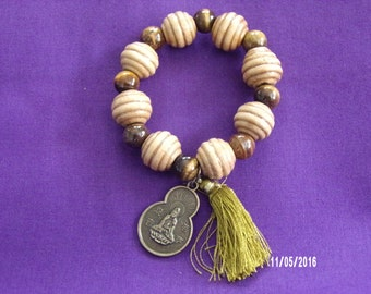 B126 Wood Beaded Bracelet with a small tassle and Chinese good luck charm.