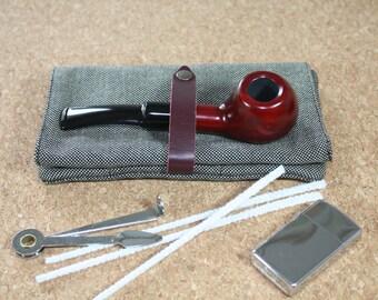 tobacco pipe / pipe pouch / tobacco from pipe / cigarette case of tobacco