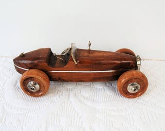 Toy car in wood and silver.
