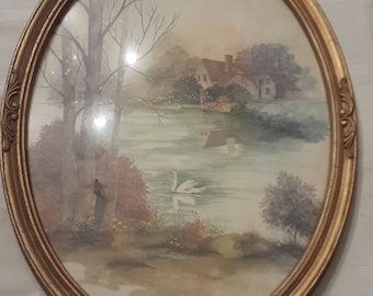 Homco Oval Picture of swans and cottage  in god plastic frame