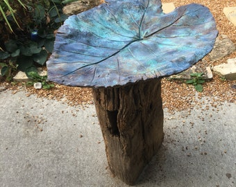 Elephant ear cast birdbath with reclaimed wood base.
