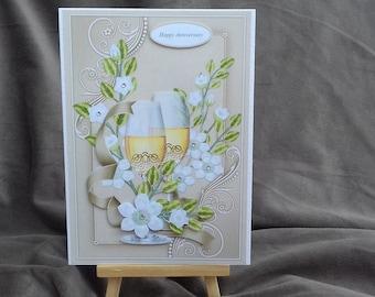 Handmade decoupaged anniversary card, champagne and flowers