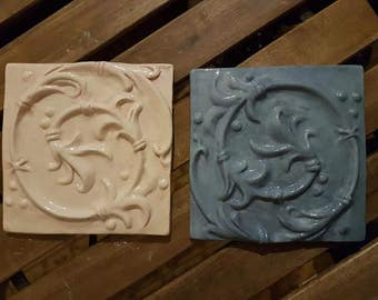 Handmade ceramic relief tile, white glaze.