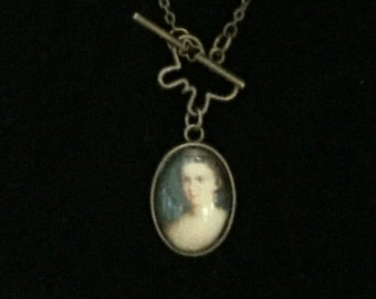 Antique looking pendant