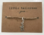 Tiny silver toned fawn or bambi progress keeper or stitch marker