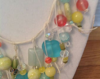 Lovely Spring colors abloom on this airy statement necklace