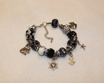 Black bead bracelet with sea charms