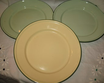 3 plates studded with green rims. Rustic enamel plate
