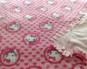 Pretty hello kitty double fleece blanket.  Sewn, not tied. 51x56