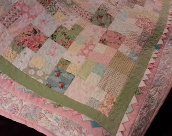 Old fashioned pretty pink quilt