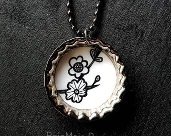 Bottlecap necklace; blossoms