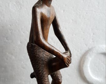 Solid wood figure of Caribbean man with drum
