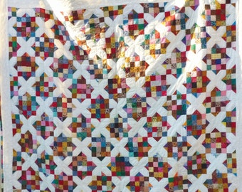 Hand crafted quilt size 84 inches by 70.5 inches.