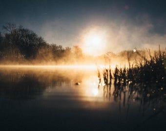 Sunrise On A Misty Lake