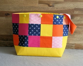 Yellow-blue-pink project bag with patchwork panels and snap buttons