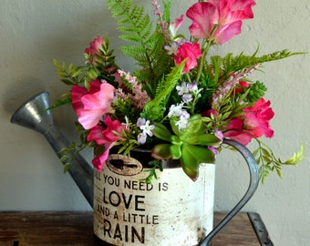 Centerpiece floral arrangement for summer, mothers day, or any day! Pink;green;succulents;watering can;rustic;metal;fern;sweet pea;peony