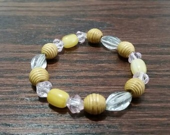 Handmade pink, yellow and clear glass and wood beaded bracelet